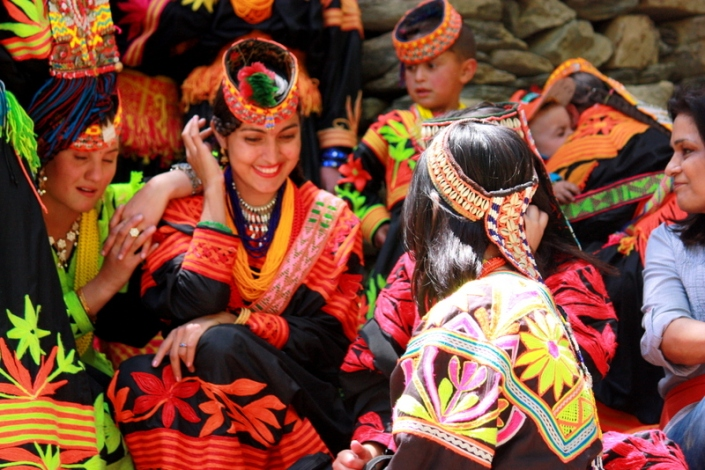 Sitting with our Kalash friends during a break in the dancing