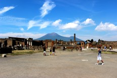 The ruined city of Pompeii, under the shadow of Mount Vesuvius